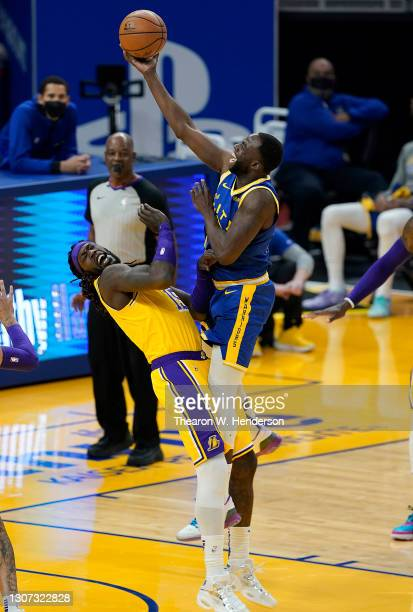 Draymond Green of the Golden State Warriors goes up for a shot but was called for an offensive foul on Montrezl Harrell of the Los Angeles Lakers...
