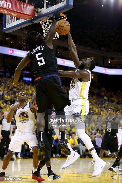 Draymond Green of the Golden State Warriors goes up for a shot on Montrezl Harrell of the LA Clippers during Game One of the first round of the 2019...