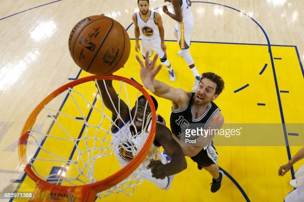 Draymond Green of the Golden State Warriors goes up for a shot against Pau Gasol of the San Antonio Spurs during Game Two of the NBA Western...