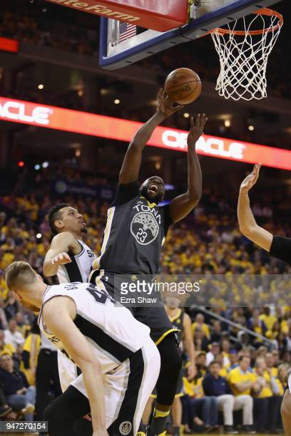 Draymond Green of the Golden State Warriors goes up for a shot against the San Antonio Spurs during Game 2 of Round 1 of the 2018 NBA Playoffs at...