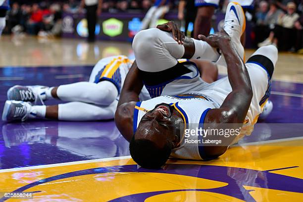 Draymond Green of the Golden State Warriors grabs his leg in pain during the game against the Los Angeles Lakers on November 25 2016 at STAPLES...