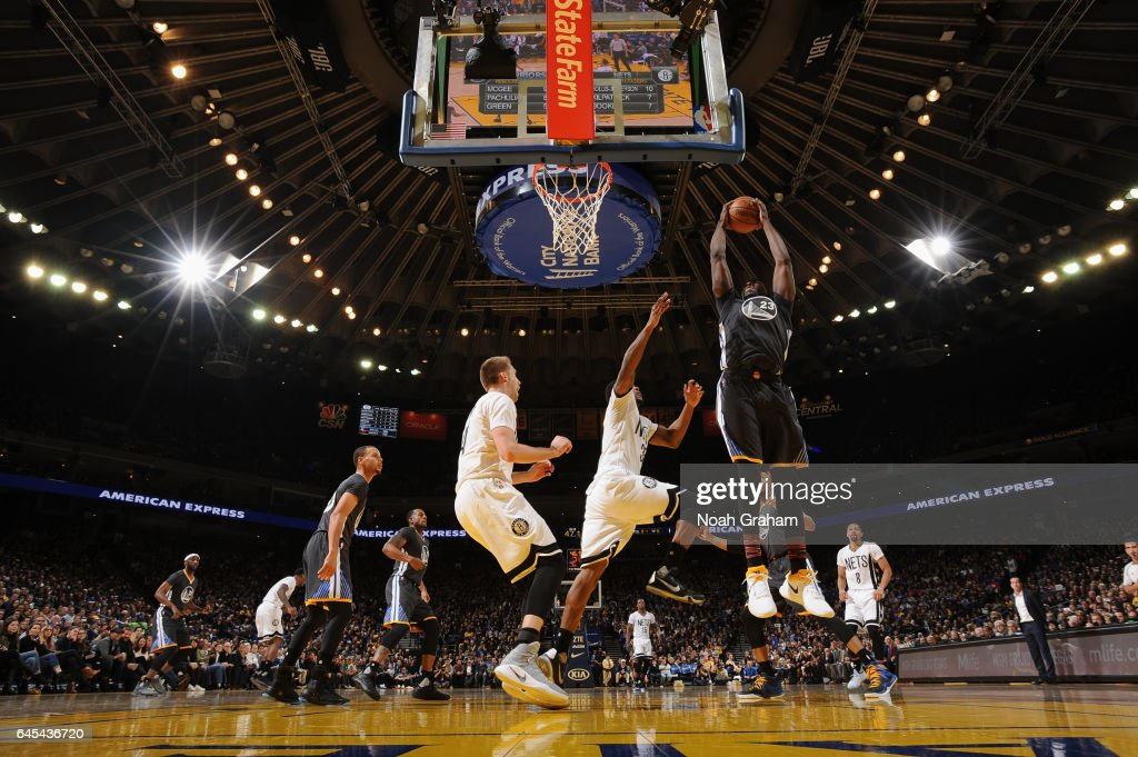 Draymond Green #23 of the Golden State Warriors grabs the rebound against the Brooklyn Nets on February 25, 2017 at ORACLE Arena in Oakland, California.
