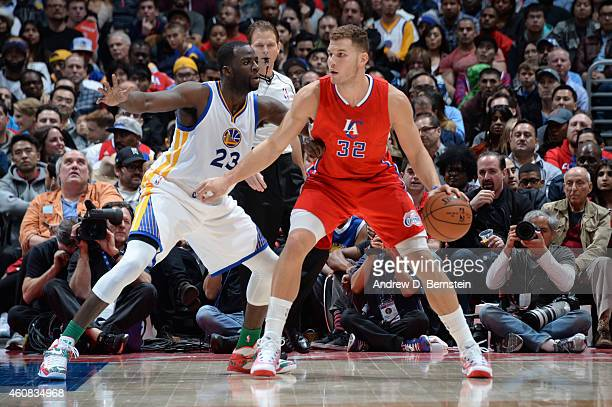 Draymond Green of the Golden State Warriors guards Blake Griffin of the Los Angeles Clippers at STAPLES Center on December 25 2014 in Los Angeles...