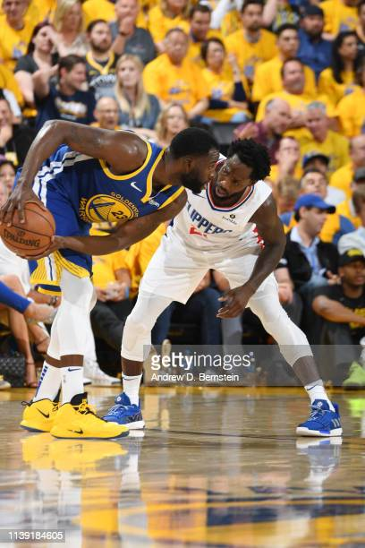 Draymond Green of the Golden State Warriors handles the ball against Patrick Beverley of the LA Clippers during Game Five of Round One of the 2019...