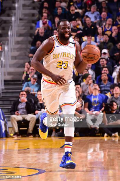 Draymond Green of the Golden State Warriors handles the ball against the Houston Rockets on February 20 2020 at Chase Center in San Francisco...