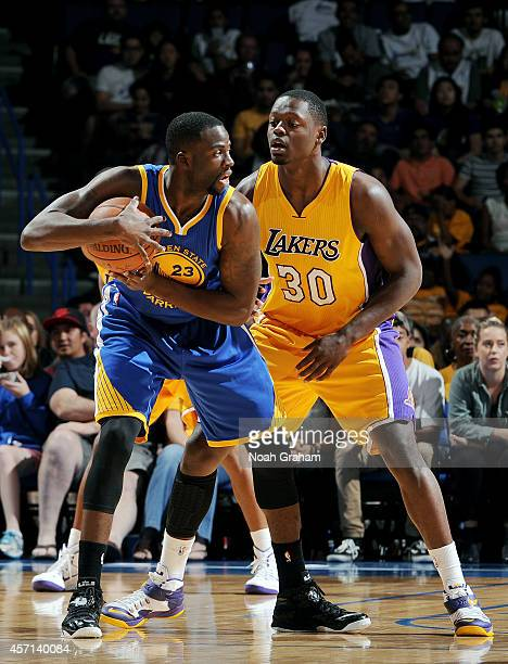 Draymond Green of the Golden State Warriors handles the ball against Julius Randle of the Los Angeles Lakers on October 12 2014 at Citizens Business...