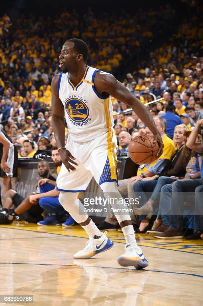 Draymond Green of the Golden State Warriors handles the ball against the San Antonio Spurs during Game Two of the Western Conference Finals of the...