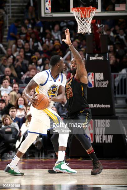 Draymond Green of the Golden State Warriors handles the ball against LeBron James of the Cleveland Cavaliers on January 15 2018 at Quicken Loans...