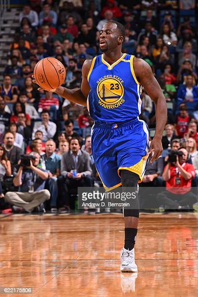 Draymond Green of the Golden State Warriors handles the ball during a game against the New Orleans Pelicans at Smoothie King Center on October 28...