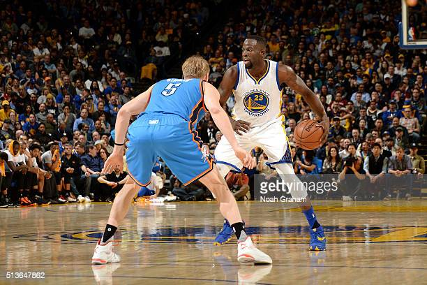 Draymond Green of the Golden State Warriors handles the ball during the game against Kyle Singler of the Oklahoma City Thunder on March 3 2016 at...