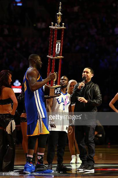 Draymond Green of the Golden State Warriors holds his trophy after defeating Kevin Hart in a three point contest prior to the Foot Locker ThreePoint...