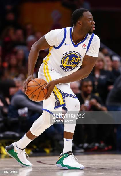 Draymond Green of the Golden State Warriors holds the ball against the Cleveland Cavaliers at Quicken Loans Arena on January 15 2018 in Cleveland...