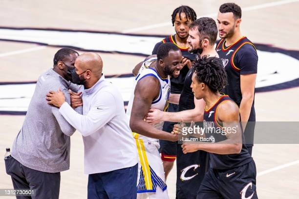 Draymond Green of the Golden State Warriors hugs Collin Sexton of the Cleveland Cavaliers after the game at Rocket Mortgage Fieldhouse on April 15,...