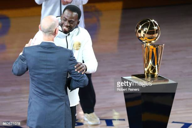 Draymond Green of the Golden State Warriors hugs NBA commissioner Adam Silver during their 2017 NBA Championship ring ceremony prior to their NBA...
