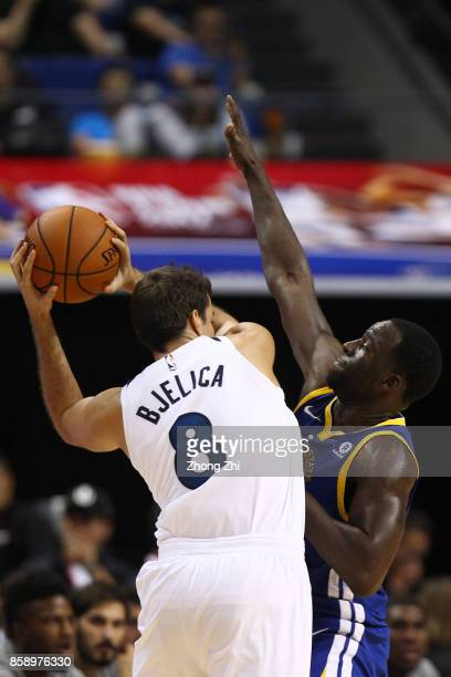 Draymond Green of the Golden State Warriors in action against Nemanja Bjelica of the Minnesota Timberwolves during the game between the Minnesota...