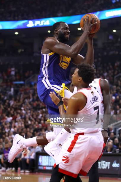 Draymond Green of the Golden State Warriors is called for a charge against Kyle Lowry of the Toronto Raptors in the second quarter during Game One of...