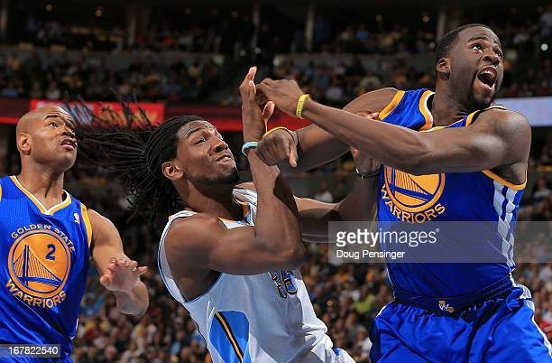 Draymond Green of the Golden State Warriors is called for a flagrant foul type one as he collides with Kenneth Faried of the Denver Nuggets during...