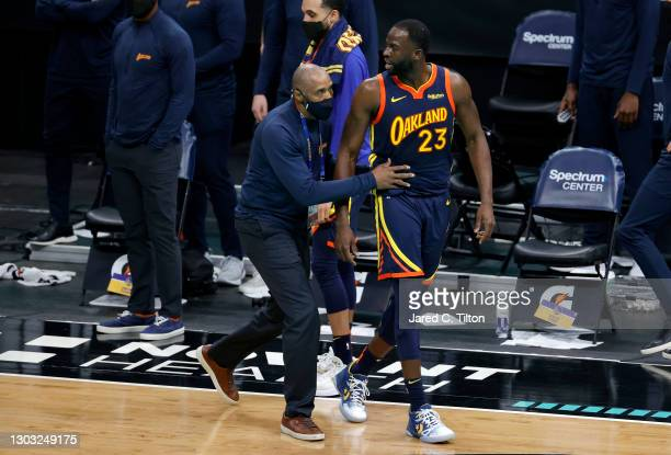 Draymond Green of the Golden State Warriors is escorted off the court following his second technical foul during the fourth quarter of their game...