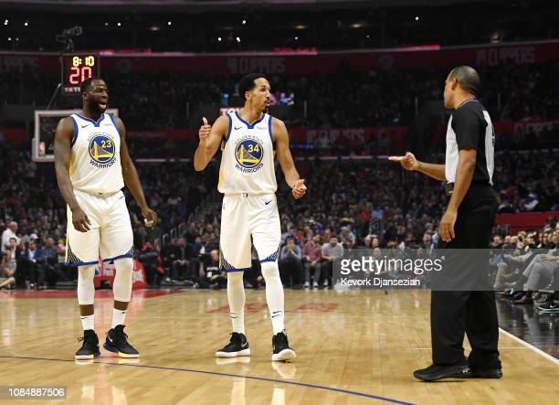 Draymond Green of the Golden State Warriors is hit with a technical foul by referee Eric Lewis as Shaun Livingston of the Golden State Warriors looks...