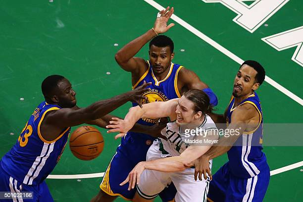 Draymond Green of the Golden State Warriors Leandro Barbosa and Shaun Livingston defend Kelly Olynyk of the Boston Celtics during double overtime at...