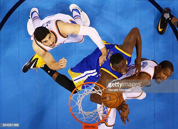 Draymond Green of the Golden State Warriors looks to rebound against Kevin Durant and Enes Kanter of the Oklahoma City Thunder in the first half in...