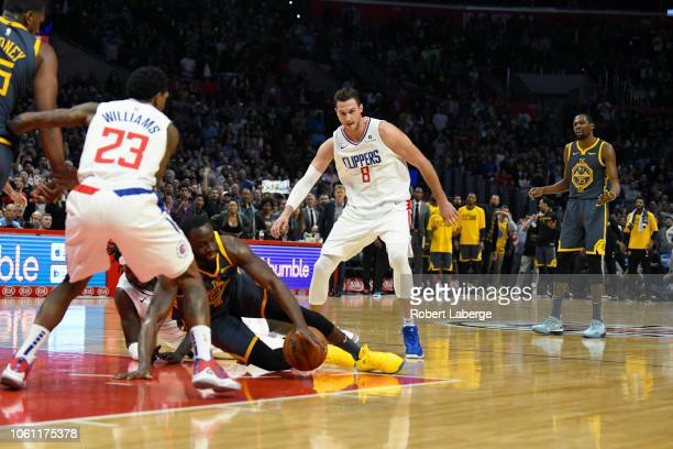 Draymond Green of the Golden State Warriors loses control of the ball in the final seconds of the fourth quarter as Kevin Durant of the Warriors...