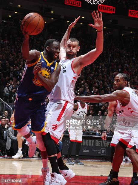 Draymond Green of the Golden State Warriors passes the ball against Marc Gasol of the Toronto Raptors during Game One of the NBA Finals on May 30,...