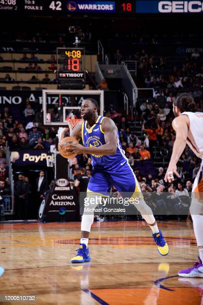 Draymond Green of the Golden State Warriors passes the ball against the Phoenix Suns on February 12 2020 at Talking Stick Resort Arena in Phoenix...