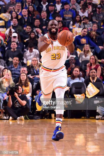 Draymond Green of the Golden State Warriors passes the ball against the Houston Rockets on February 20 2020 at Chase Center in San Francisco...