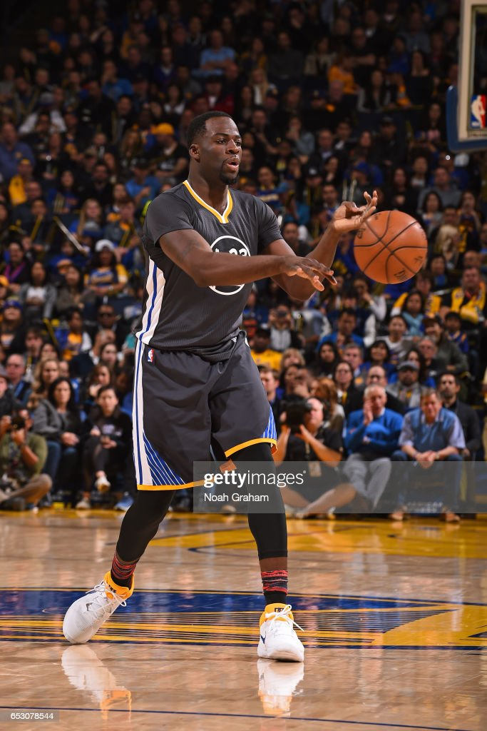 Draymond Green #23 of the Golden State Warriors passes the ball against the Brooklyn Nets on February 25, 2017 at ORACLE Arena in Oakland, California.