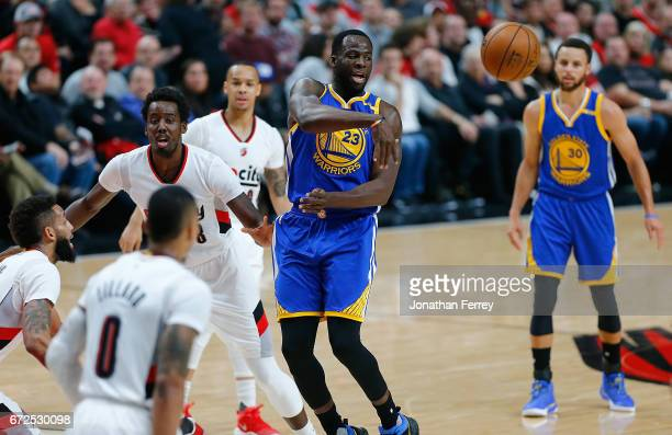 Draymond Green of the Golden State Warriors passes the ball against Al Forouq Aminu of the Portland Trail Blazers during Game Four of the Western...