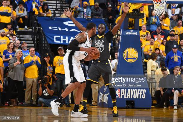Draymond Green of the Golden State Warriors plays defense against the San Antonio Spurs in Game Two of Round One of the 2018 NBA Playoffs on April 16...