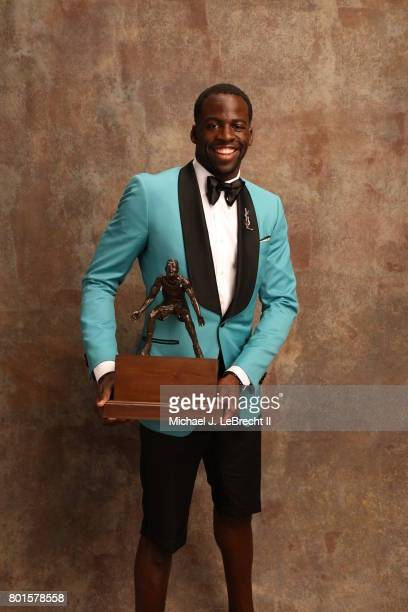 Draymond Green of the Golden State Warriors poses for a portrait after receiving the Kia NBA Defensive Player of the Year Award at the NBA Awards...