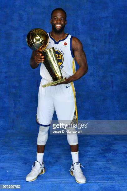 Draymond Green of the Golden State Warriors poses for a portrait with the Larry O'Brien Championship trophy after defeating the Cleveland Cavaliers...