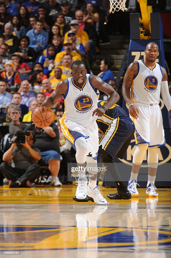 Draymond Green #23 of the Golden State Warriors pushes the ball against the Utah Jazz on November 21, 2014 at Oracle Arena in Oakland, California.