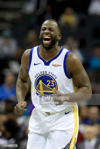 Draymond Green of the Golden State Warriors reacts after a play against the Charlotte Hornets during their game at Spectrum Center on December 04...