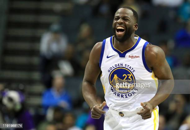 Draymond Green of the Golden State Warriors reacts after a play against the Charlotte Hornets during their game at Spectrum Center on December 04,...