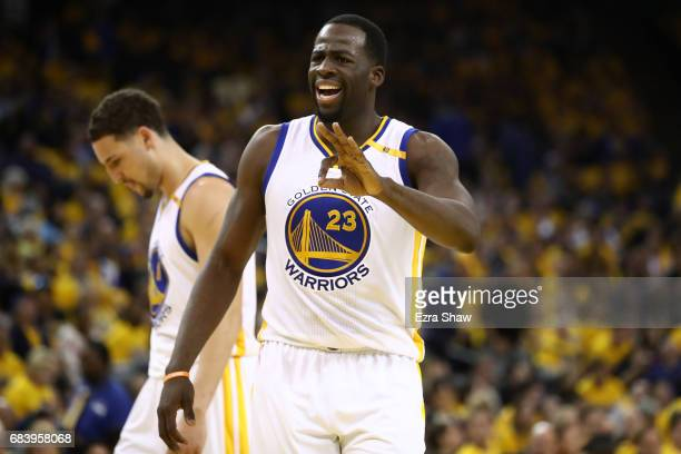 Draymond Green of the Golden State Warriors reacts after a play against the San Antonio Spurs during Game Two of the NBA Western Conference Finals at...