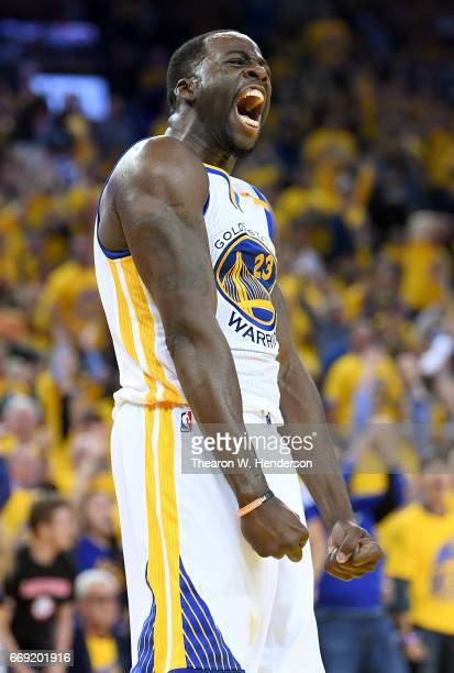 Draymond Green of the Golden State Warriors reacts after blocking the shot of Noah Vonleh of the Portland Trail Blazers in the third quarter during...