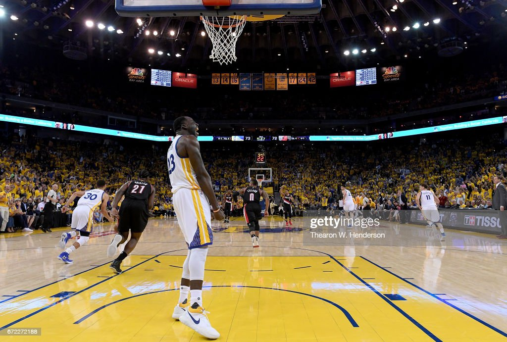 Draymond Green #23 of the Golden State Warriors reacts after blocking the shot of Noah Vonleh #21 of the Portland Trail Blazers in the third quarter during Game One of the first round of the 2017 NBA Playoffs at ORACLE Arena on April 16, 2017 in Oakland, California.