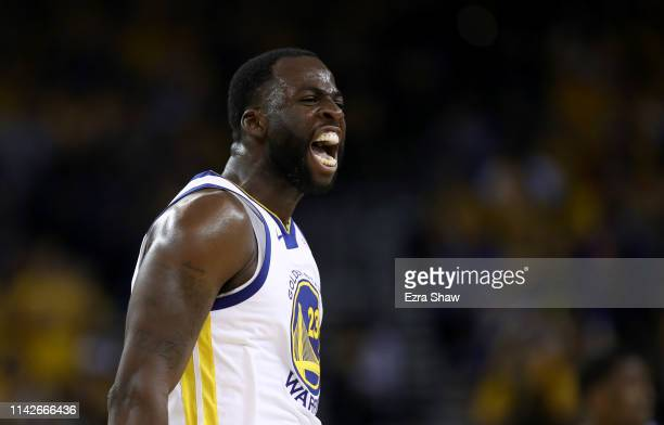 Draymond Green of the Golden State Warriors reacts after he made a basket against the LA Clippers during Game One of the first round of the 2019 NBA...