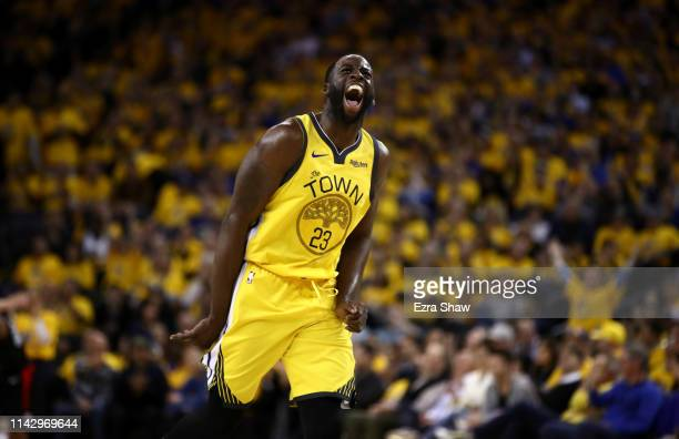 Draymond Green of the Golden State Warriors reacts after he made a basket against the LA Clippers during Game Two of the first round of the 2019 NBA...