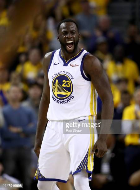 Draymond Green of the Golden State Warriors reacts after he made a basket against the Houston Rockets during Game Five of the Western Conference...