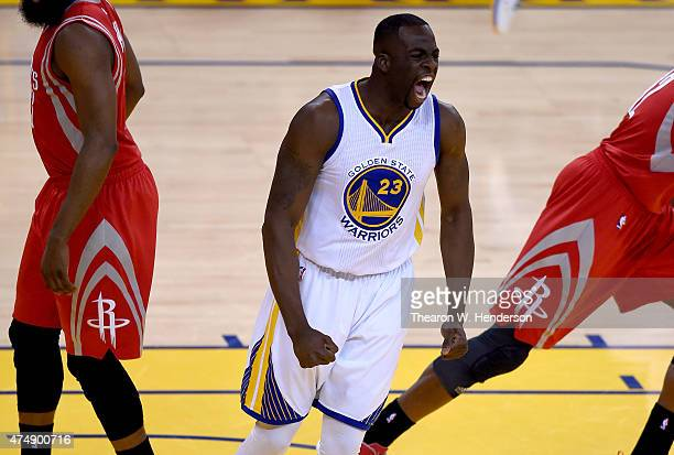 Draymond Green of the Golden State Warriors reacts after making a basket in the first quarter against the Houston Rockets during game five of the...