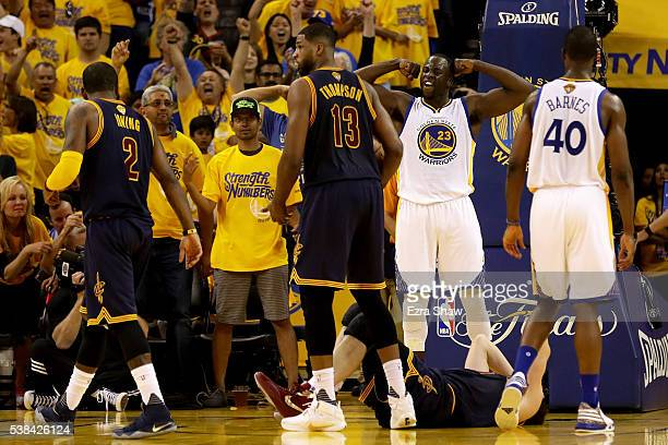 Draymond Green of the Golden State Warriors reacts in the second quarter of Game 2 of the 2016 NBA Finals against the Cleveland Cavaliers at ORACLE...