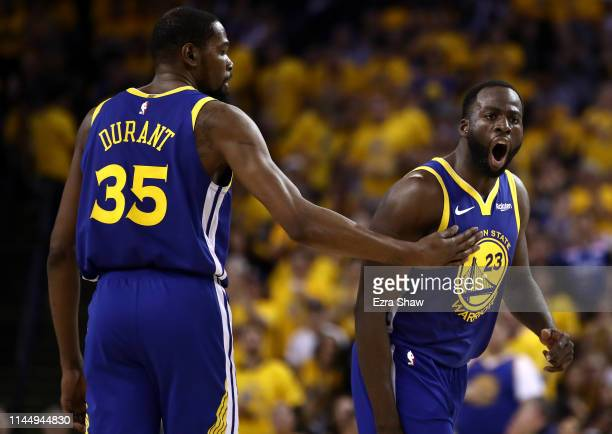 Draymond Green of the Golden State Warriors reacts to a call as Kevin Durant holds him back during their game against the LA Clippers during Game...