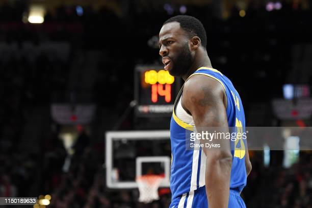 Draymond Green of the Golden State Warriors reacts to a call during the first half in game three of the NBA Western Conference Finals against the...