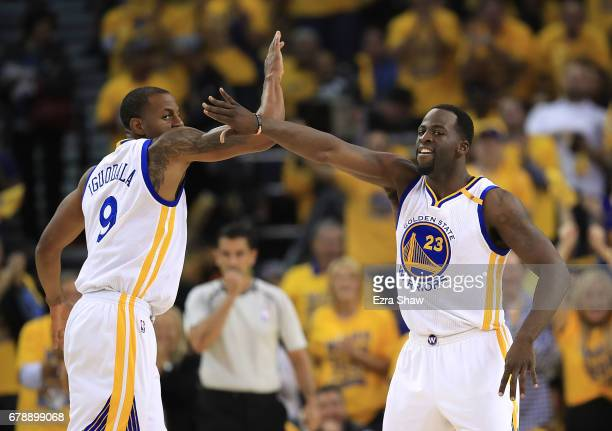 Draymond Green of the Golden State Warriors reacts with Andre Iguodala after hitting a threepoint basket against the Utah Jazz during Game Two of the...
