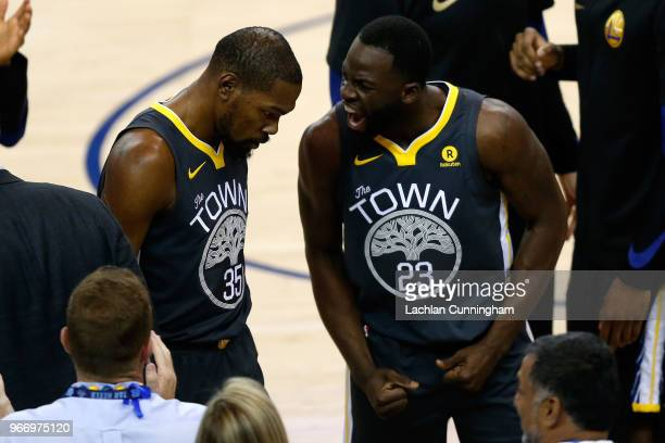 Draymond Green of the Golden State Warriors reacts with Kevin Durant against the Cleveland Cavaliers during the first quarter in Game 2 of the 2018...