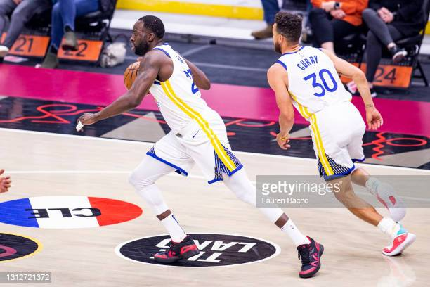 Draymond Green of the Golden State Warriors runs down the court after a rebound during the first quarter against the Cleveland Cavaliers at Rocket...